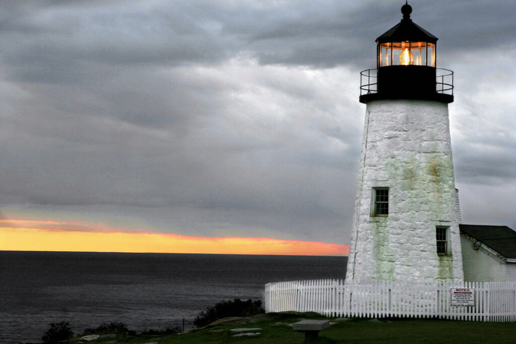 The sun sets behind Pemaquid Point Lighthouse in 2005. The winter sun goes down earlier in the day in eastern Maine towns than anywhere else in the continental United States.
