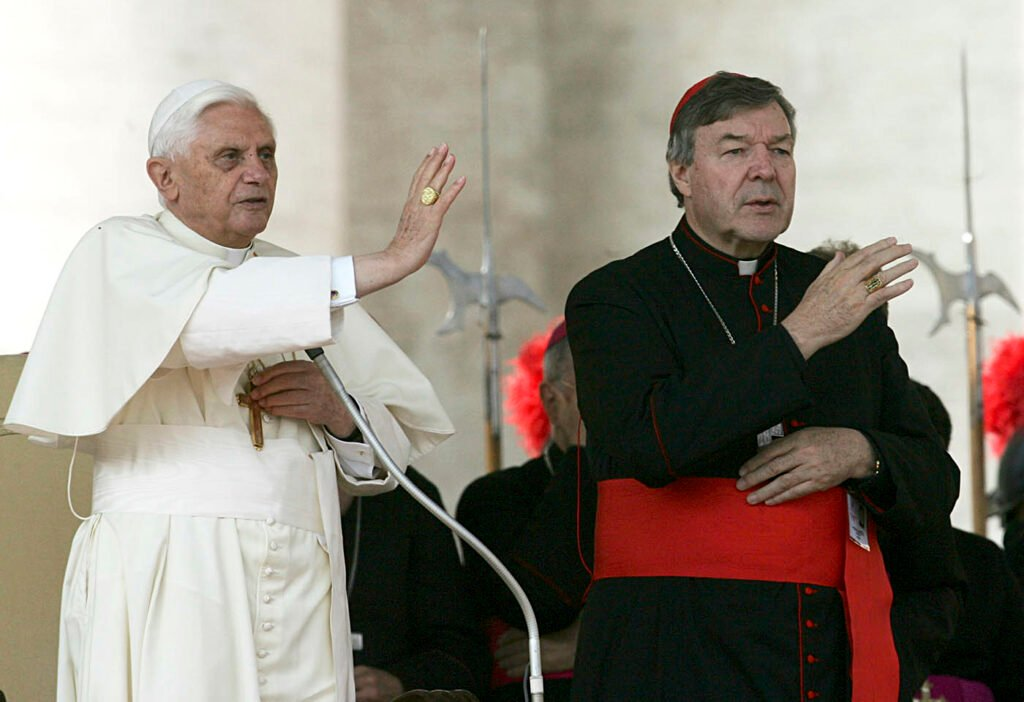 Pope Benedict XVI, left, and Cardinal George Pell bless the faithful during the weekly general audience in St. Peter's square at the Vatican in 2005. Cardinal George Pell was sentenced in an Australian court on Wednesday, March 13, 2019 to 6 years in prison for molesting two choirboys in a Melbourne cathedral more than 20 years ago.