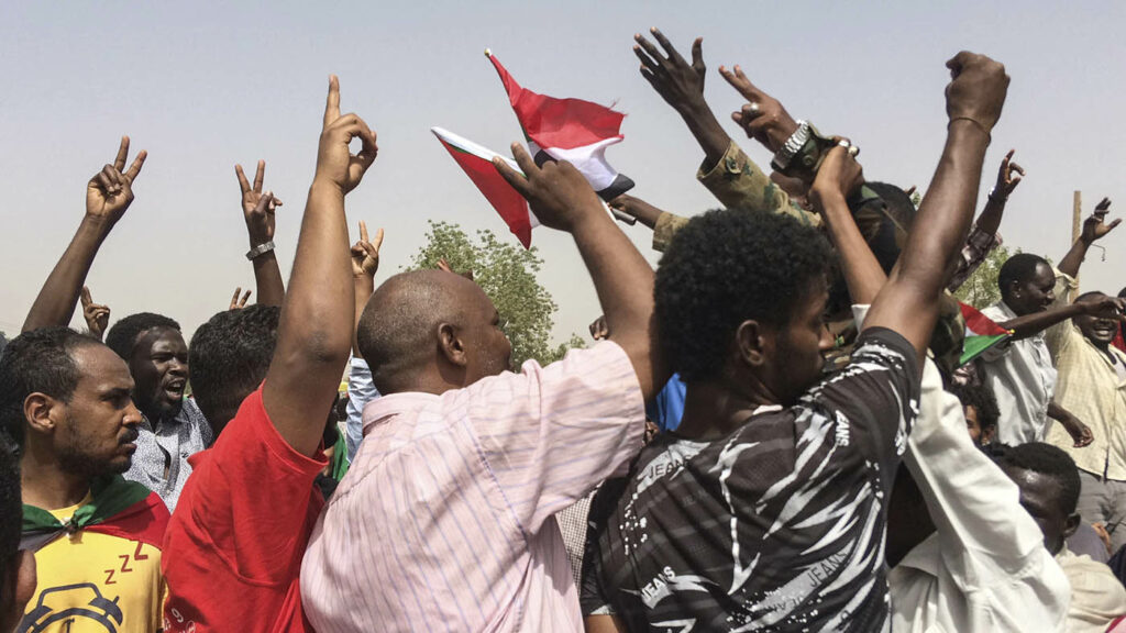 Sudanese celebrate after officials said the military had forced longtime autocratic President Omar al-Bashir to step down after 30 years in power in Khartoum on Thursday.