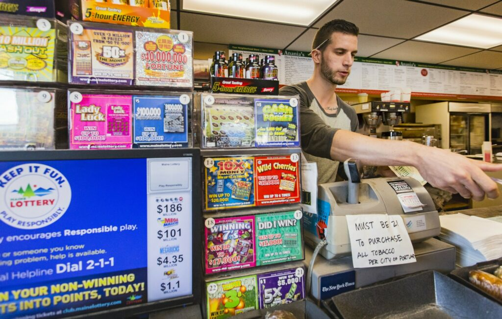 Lottery tickets are displayed at the counter at Anania's in Portland in 2016. The display advises people to play responsibly, but mental health advocates say the state doesn't have adequate resources to deal with problem gambling.