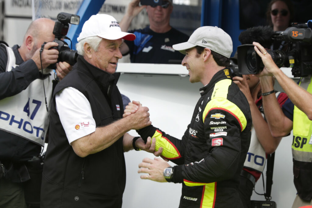 Simon Pagenaud is congratulated by car owner Roger Penske after winning the pole last weekend for today's Indianapolis 500. Penske's team has won the event 17 times.