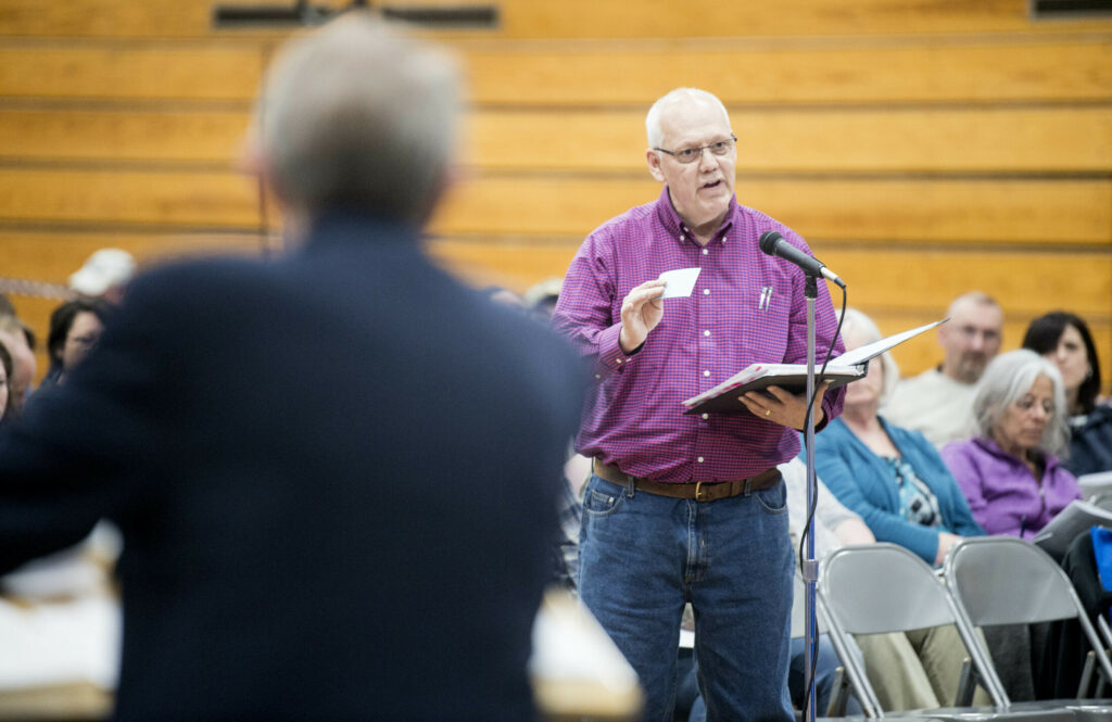 Steve Grenier, a former school board member, discusses budget concerns Tuesday with the school board during a SAD 49 school budget meeting at Lawrence Junior High School in Fairfield.