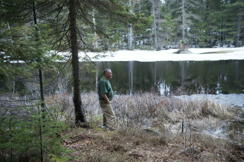 Kaleb Jacob stands along Whipple Bog near Whipple Pond on April 24 near where the proposed New England Clean Energy Connect power transmission line would be built. Jacob worries about the power line's effect on fishing and wildlife in the area and the implications for tourism.