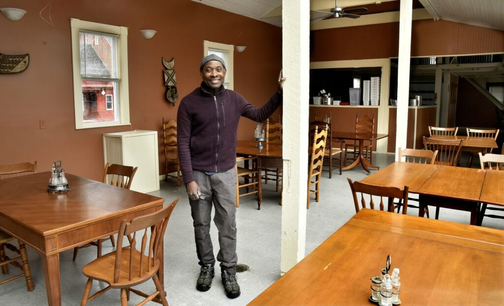 Jordan Benissan, owner of the new Me Lon Togo restaurant, stands in the dining room Thursday of his restaurant on Main Street in Waterville that will feature African dishes.