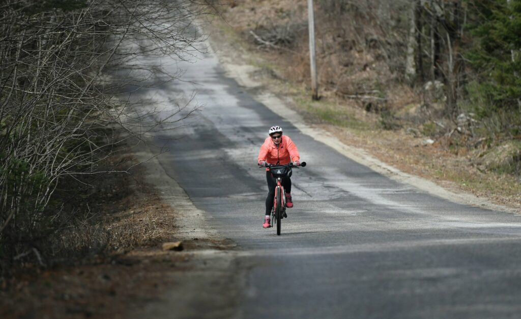 Joan Churchill takes her e-bike out for a spin in Buckfield. The electric assist means she is biking more than ever.