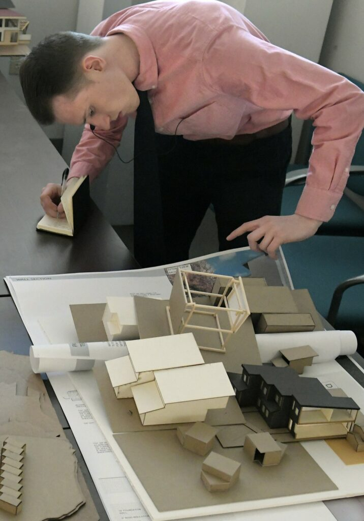 Keegan Smith, of Lebanon, prepares his presentation for affordable housing designs May 6 at the University of Maine Augusta. Students enrolled in the school's architecture program devoted a semester to studying affordable housing and presented their plans to a group of housing advocates, architects and designers.