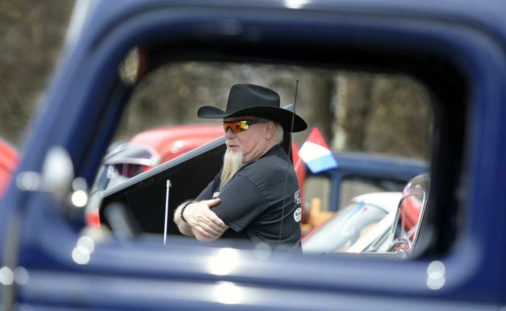 Walter Willey of Fairfield Center inspects cars on display Sunday during the cruise at the CARA fields. A fundraiser was held to replace a building at the complex destroyed by fire.