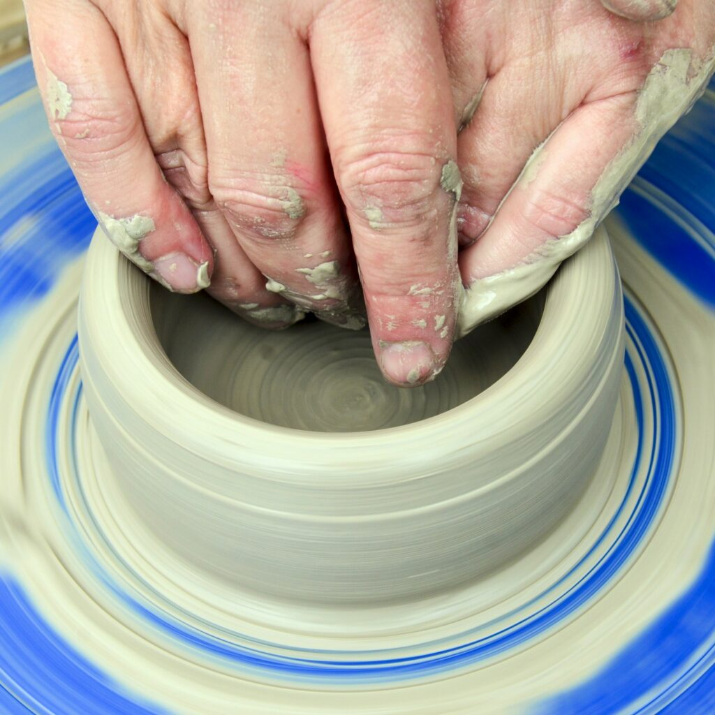 Lori Watts demonstrates throwing a bowl on a wheel during a Maine Pottery Tour event on Saturday at Fine Mess Pottery in Augusta.