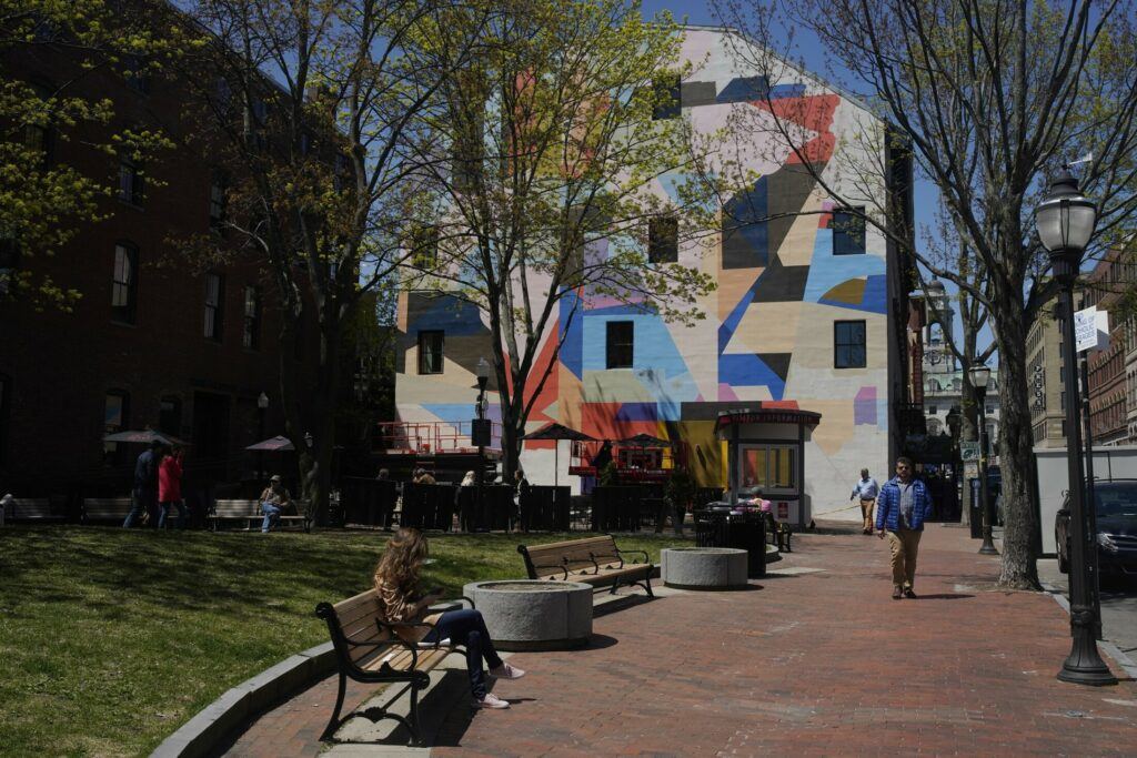 The new mural by local artist Will Sears on Exchange Street in downtown Portland is getting mixed but mostly positive reviews.