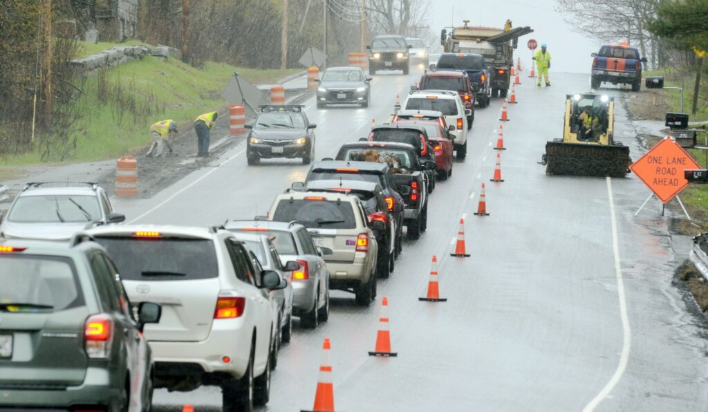 Pavement milling on shoulders of Route 3 continues in the rain Friday in Augusta.