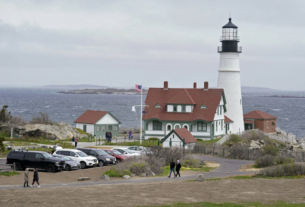People visit Portland Head Light at Fort Williams Park in Cape Elizabeth in May 2019.