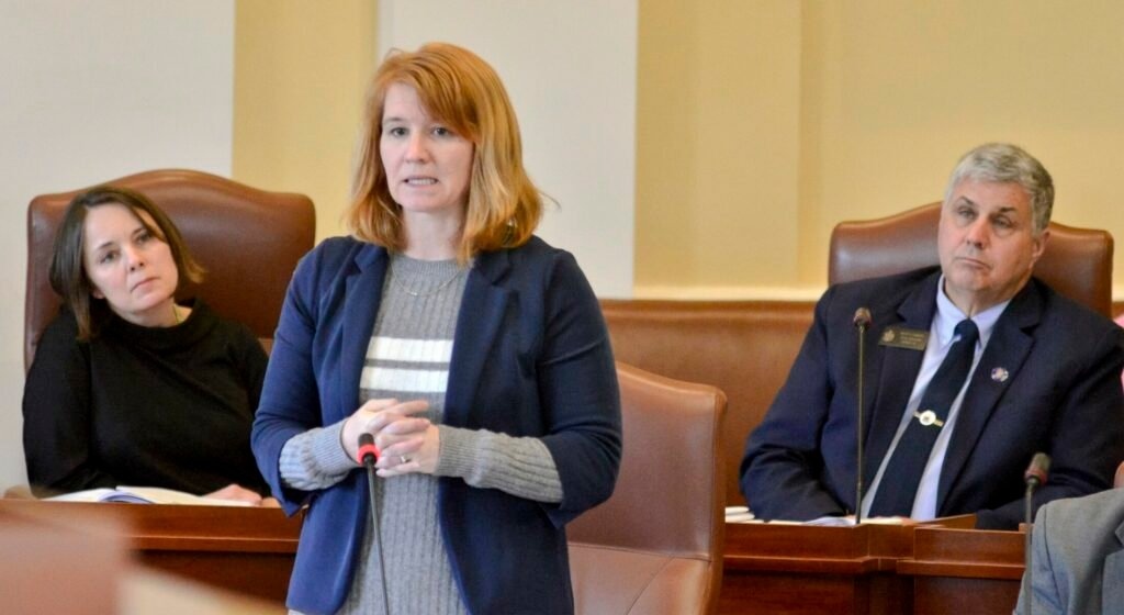Sen. Heather Sanborn, D-Portland, speaks during debate Tuesday on a bill to remove religious exemptions from the state's school vaccination law. Sens. Shenna Bellows, D-Manchester, and Scott Cyrway, R-Albion, listen behind her.