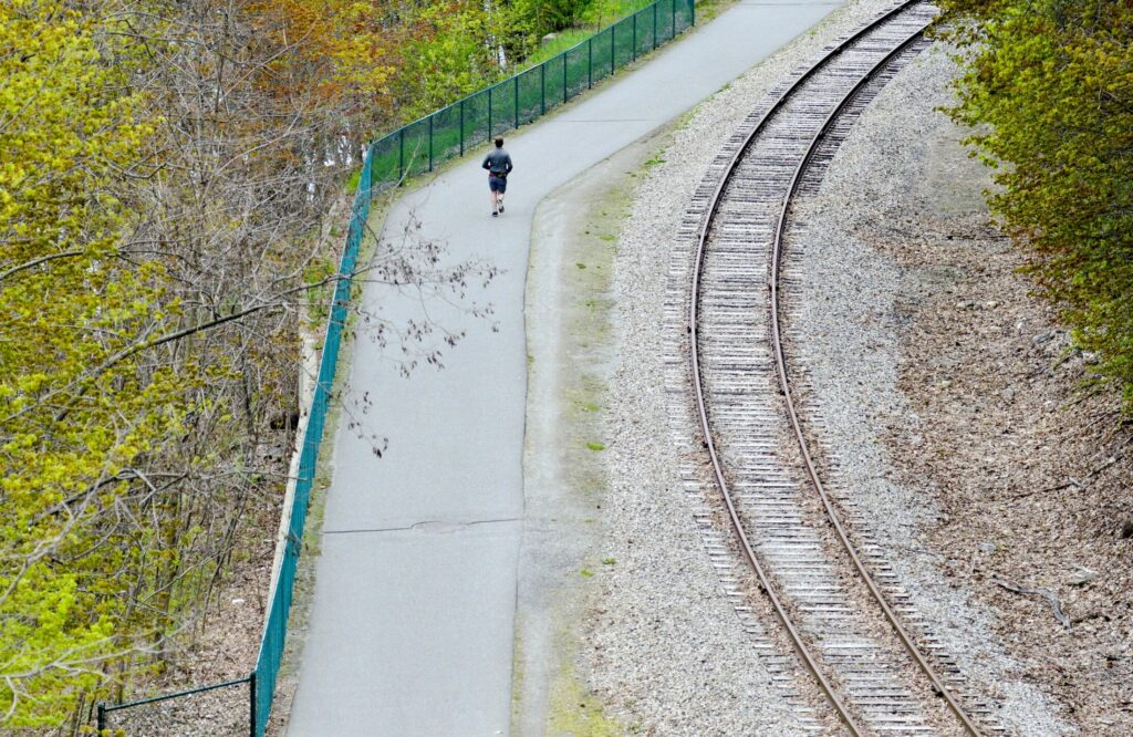 A runner heads south along the Kennebec River Rail Trail on Wednesday in Augusta. The trail currently runs from downtown Augusta through Hallowell and Farmingdale to Gardiner. There is a proposal to create the Merrymeeting Trail, which would connect the Kennebec River Trail to a system in Topsham.