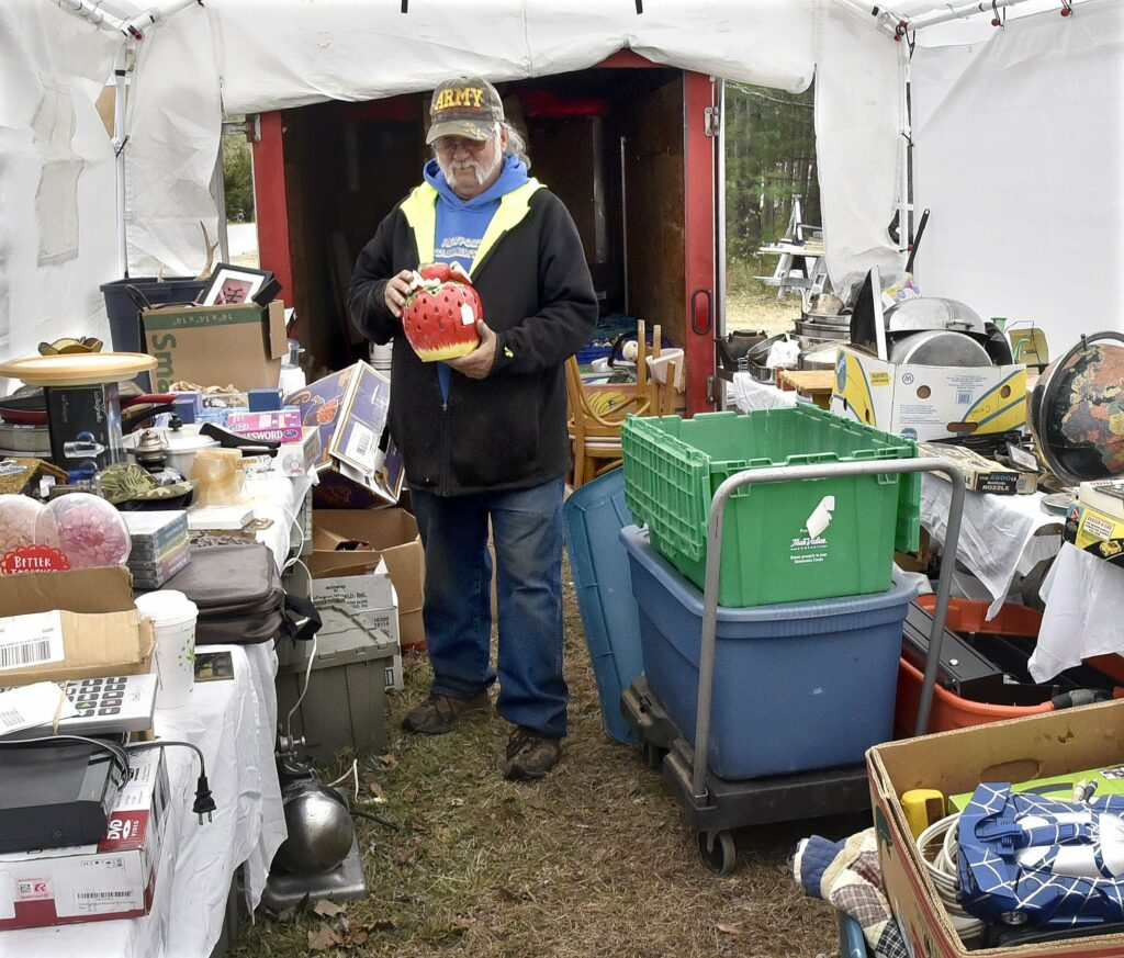 Lawrence Bowley fills a tent Wednesday in Skowhegan with items to sell during this weekend's 36th annual 10-Mile Yard Sale. Bowley also will sell grilled food to benefit the Unity Area Volunteer Food Pantry.