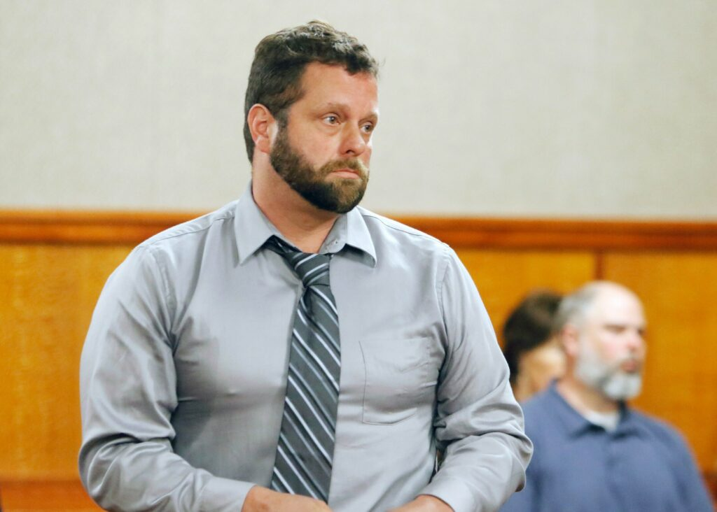 Shawn Purvis stands in court May 20 during his arraignment on charges in the death of a worker who fell from the roof of a house on Munjoy Hill in December 2018.