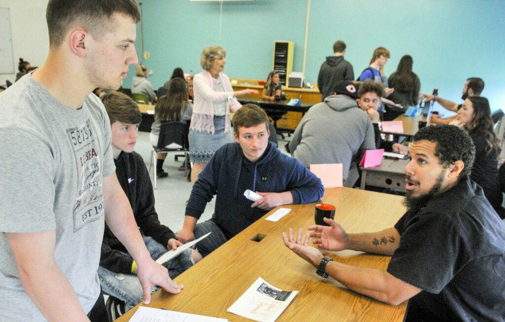 Class of 2012 graduate Eddie Donnell, far right, talks to students about his career as a nurse during an alumni event Thursday at Gardiner Area High School.