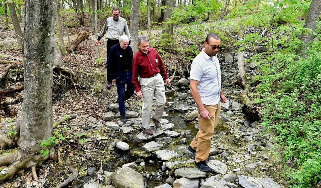 The Oxbow Trail in Waterville will receive a cleaning on Saturday, June 1, National Trails Day. Walking along the trail off Cool Street in Waterville from left are Jim Shipsky, Elery Keene, Peter Garrett and Ash Hekmat.