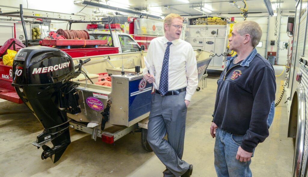 Readfield Town Manager Eric Dyer, left, and Fire Chief Lee Tank talk during a tour of the Readfield Fire Department's Harriman Station on May 23 in Readfield. A plan for an expansion of the station is on the upcoming ballot.