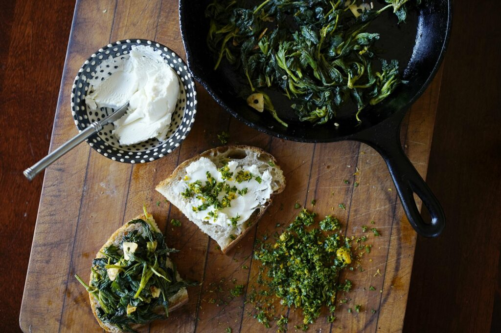 The makings for a goat cheese and nettle sandwich. The nettles are blanched to remove the sting.
