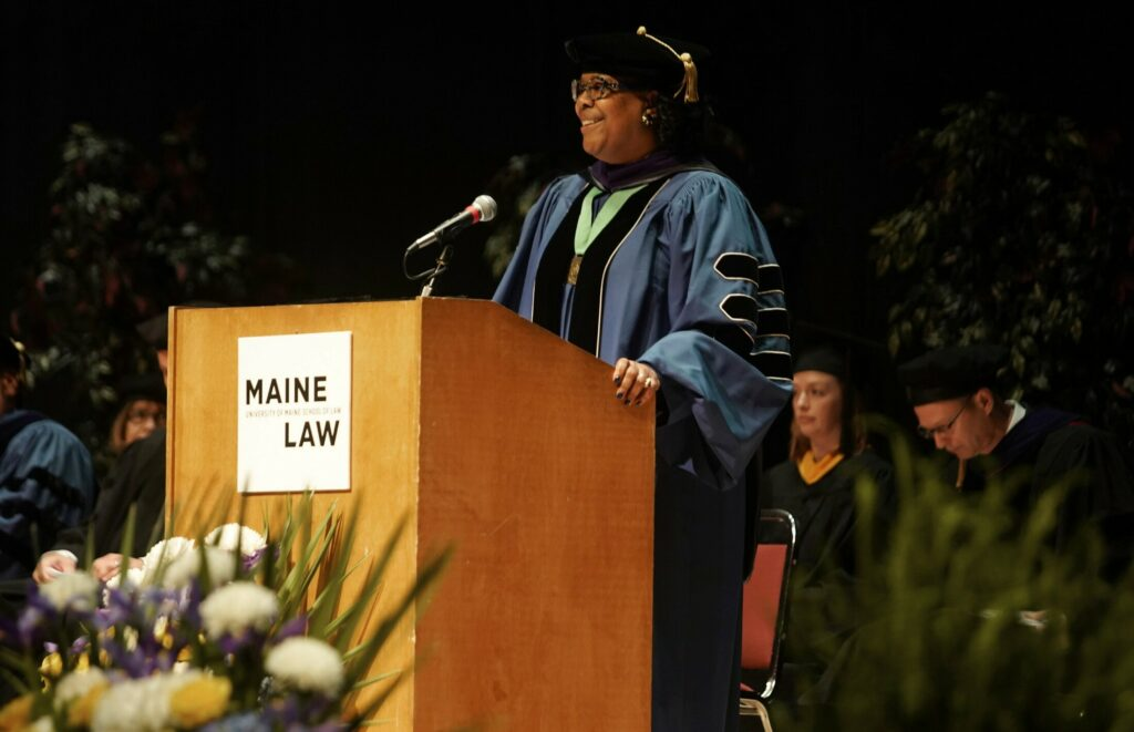 University of Maine School of Law's Dean Danielle Conway speaks at the commencement ceremony on Saturday. The graduation was Conway's last as the dean.
