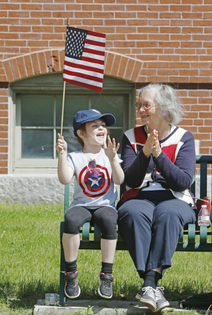 WESTBROOK, ME - MAY 27: Lucy Seavey, 6, and her nanny, Rosemarie Brown, enjoy the Memorial Day parade along Main Street Monday morning. (Staff photo by Jill Brady/Staff Photographer.)