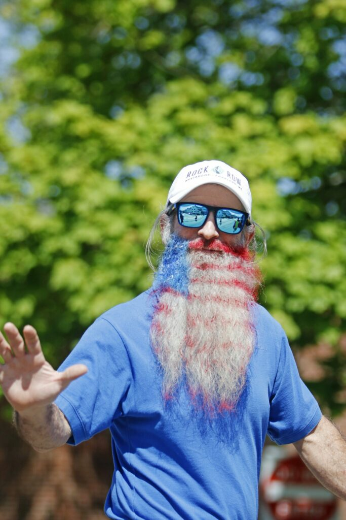 WESTBROOK, ME - MAY 27: Larry McWilliams, a Ward 5 city councilman, shows off his patriotic beard while marching in the Memorial Day parade Monday morning. (Staff photo by Jill Brady/Staff Photographer.)