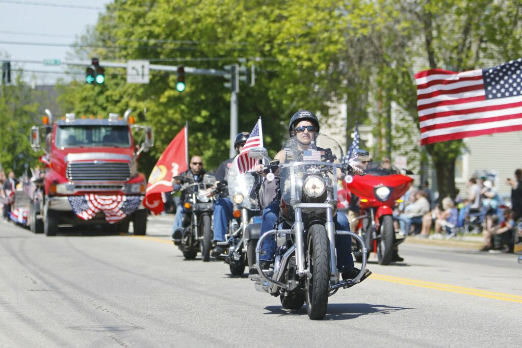 WESTBROOK, ME - MAY 27: Bikers travel with colors down Main Street during the Memorial Day parade Monday morning. (Staff photo by Jill Brady/Staff Photographer.)