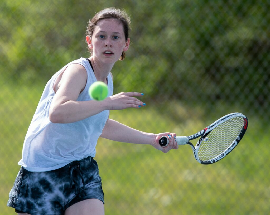 Grace Campanella, of Kennebunk-Wells lines up a shot during her match against York's Daphne Stratton-Gignac  during Saturday's MPA Singles Championships at Lewiston High School.