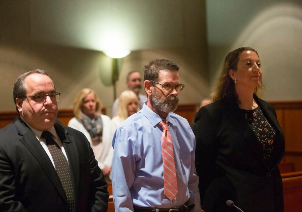 Gregory Vance stands next to his attorneys, Robert LaBrasseur and Tina Heather Nadeau, during his arraignment Wednesday. He pleaded not guilty to a murder charge in the death of his girlfriend, Patricia Grassi.