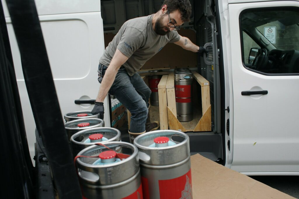 Britton Beal, a drayman at Goodfire Brewing Co., loads a truck before making deliveries in Portland on Thursday. Legislators are considering a new law that would let Maine brewers produce much more beer before having to sign agreements with distribution companies. The change would give craft brewers more flexibility to grow and distribute on their own terms, supporters say.