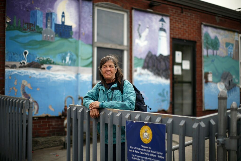 Cheryl McAllister, 62, poses for a portrait outside Oxford Street Shelter on Thursday. She's been staying at the shelter since 2002.