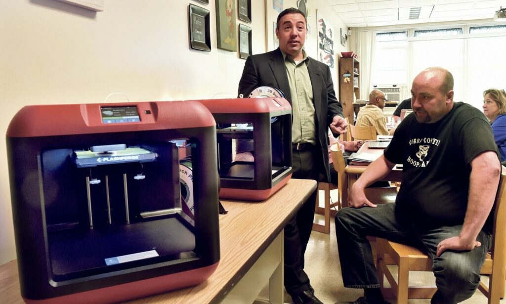 RSU 74 residents approved a revised budget at a district meeting on May 30. Superintendent Mike Tracy, left at a 3-D printer training session for teachers, will meet with residents of Embden, Solon and New Portland this week to address the budget that goes to referendum on June 11.