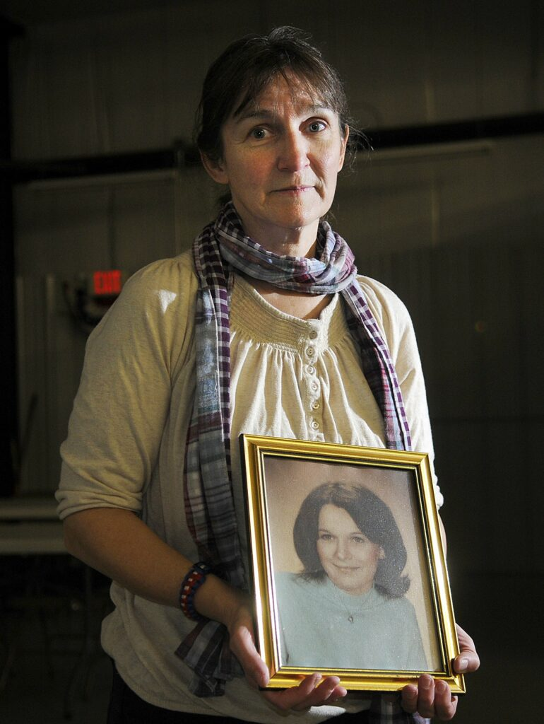 West Gardiner resident Vicki Dill, seen in 2013 holding a photo of her sister Debra, opposed the parole of Michael Boucher on Monday. Boucher was convicted in 1991 for beating Debra Dill, 18, to death with a hammer in 1973 in Litchfield.