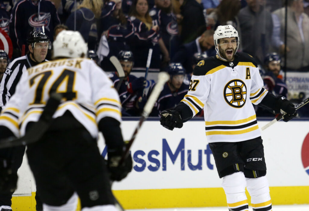Patrice Bergeron, right, celebrates the first of his two power-play goals Thursday night against the Columbus Blue Jackets.