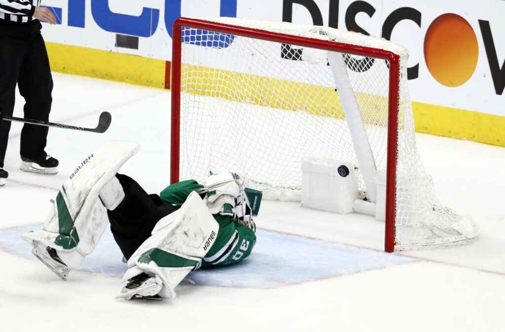 Stars goalie Ben Bishop lies on the ice as a shot gets past him and into the net during Dallas' 4-1 loss to the St. Louis Blues in Game 6 of their Western Conference semifinal series on Sunday in Dallas. The Blues forced Game 7 with the win.