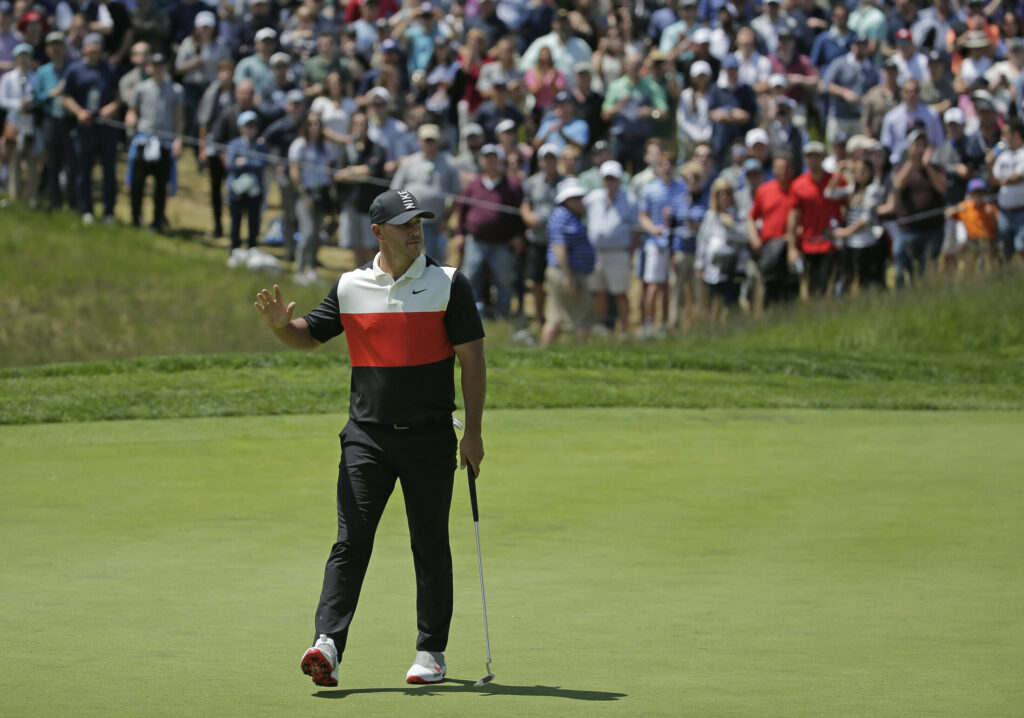 Brooks Koepka reacts after sinking a putt for birdie on the fifth green during the first round of the PGA Championship golf tournament Thursday at Bethpage Black in Farmingdale, N.Y.