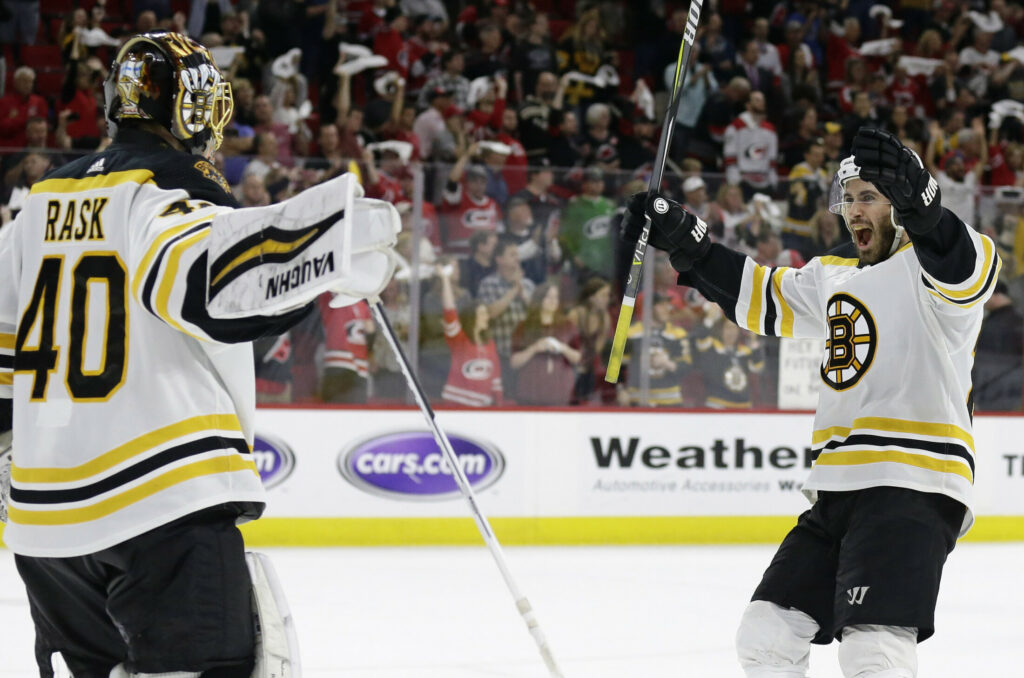 Bruins goalie Tuukka Rask celebrates with John Moore at the end of Game 4 of the NHL Eastern Conference finals against the Carolina Hurricanes in Raleigh, N.C., on Thursday night. Boston won 4-0 to advance to the Stanley Cup Final.