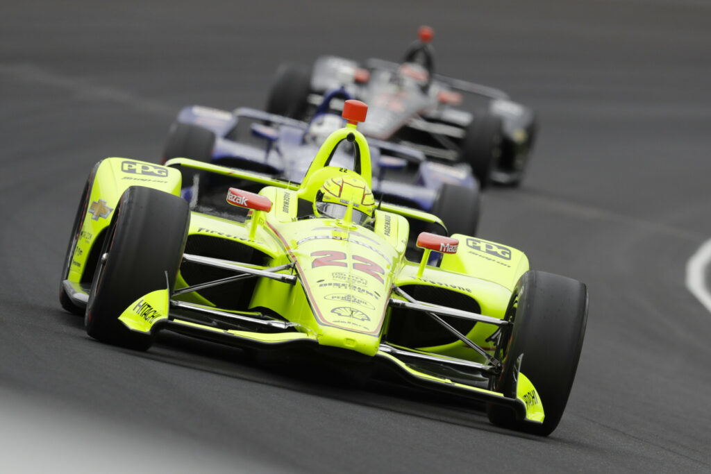 Simon Pagenaud leads a pack through the first turn during the Indy 500 on Sunday at Indianapolis Motor Speedway in Indianapolis. Pagenaud earned his first Indy 500 victory, winning a duel with Alexander Rossi.