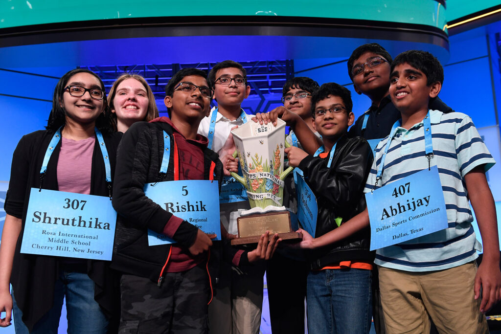 The eight co-champions of the 2019 Scripps National Spelling Bee, from left, Shruthika Padhy, 13, of Cherry Hill, N.J., Erin Howard, 14, of Huntsville, Ala., Rishik Gandhasri, 13, of San Jose, Calif., Christopher Serrao, 13, of Whitehouse Station, N.J., Saketh Sundar, 13, of Clarksville, Md., Sohum Sukhatankar, 13, of Dallas, Texas, Rohan Raja, 13, of Irving, Texas, and Abhijay Kodali, 12, of Flower Mound, Texas, hold the trophy at the end of the competition early Friday in Oxon Hill, Md.