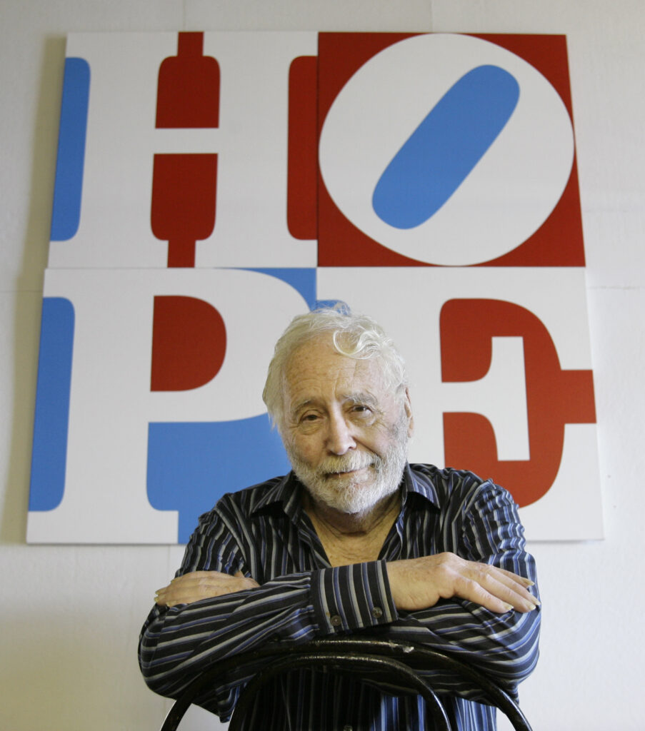 "Artist Robert Indiana poses at his Vinalhaven studio in 2008 with ""HOPE,"" which he created for Barack Obama's presidential campaign."