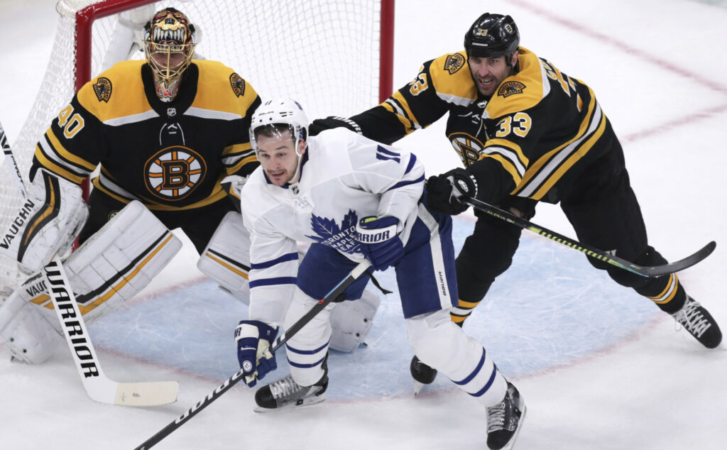 Bruins defenseman Zdeno Chara, right, is expected to be back in the lineup Monday night after missing the last game of the Eastern Conference finals.