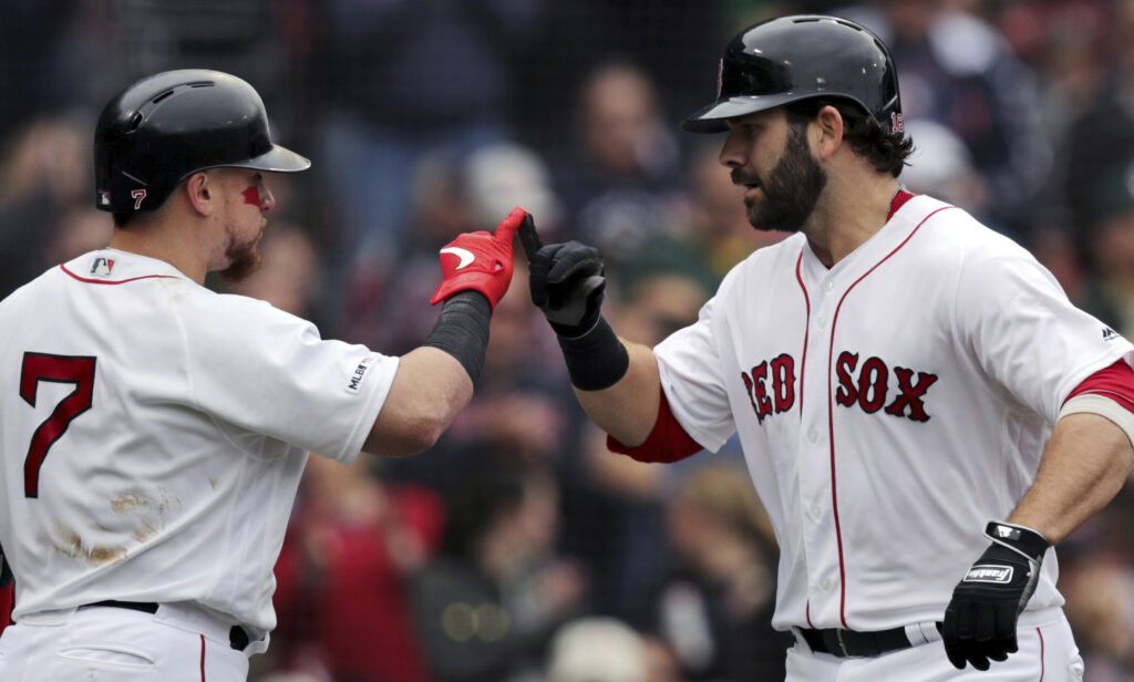 Mitch Moreland, right, celebrates with Christian Vazquez after hitting a solo home run in Boston's 7-3 win over Oakland on Wednesday at Fenway Park.