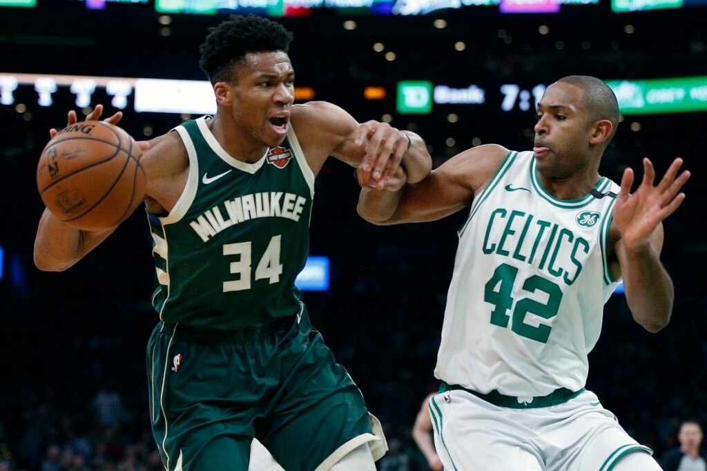 Al Horford of the Celtics defends Giannis Antetokounmpo of the Bucks during Milwaukee's 113-101 win in Game 4 of their Eastern Conference semifinal series on Monday in Boston.