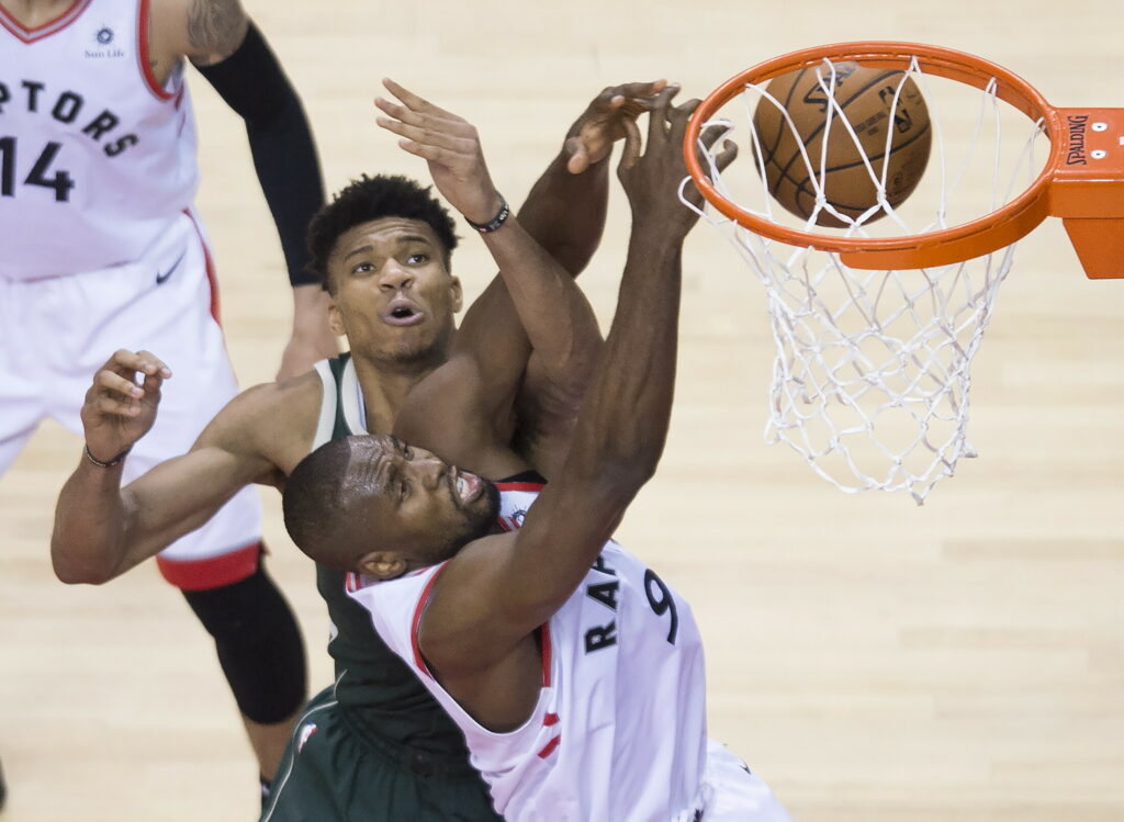 Raptors center Serge Ibaka battles for the ball against Bucks forward Giannis Antetokounmpo during the second half of Game 4 of the Eastern Conference finals Tuesday in Toronto.