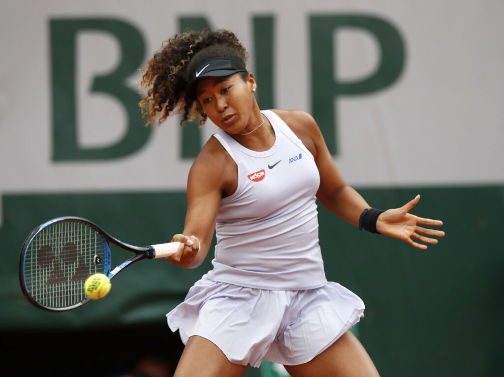 Naomi Osaka, the top seed at the French Open, plays a shot against Anna Karolina Schmiedlova during their first round match Tuesday at Roland Garros in Paris, Tuesday. Osaka rallied to win 0-6, 7-6 (4), 6-1.