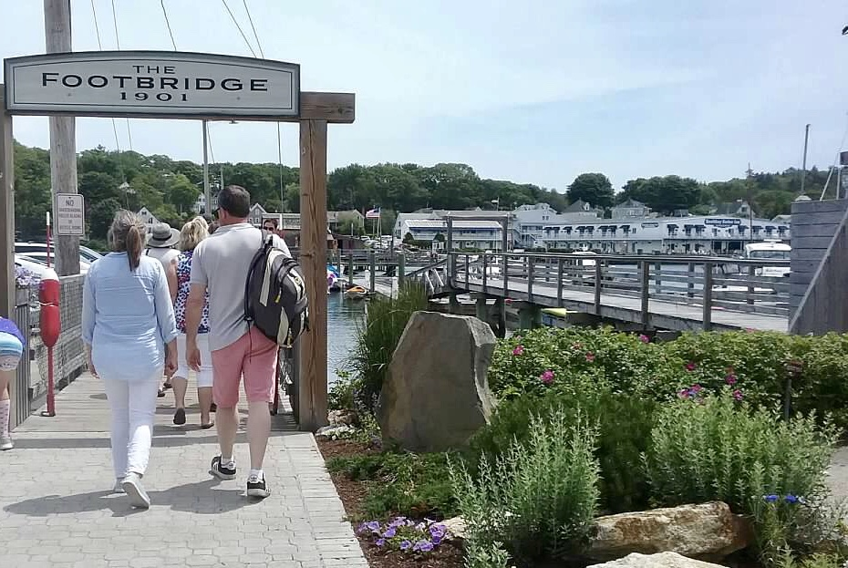 The footbridge at Boothbay Harbor is a good place to wait and watch for the windjammer fleet to arrive during Windjammer Days.