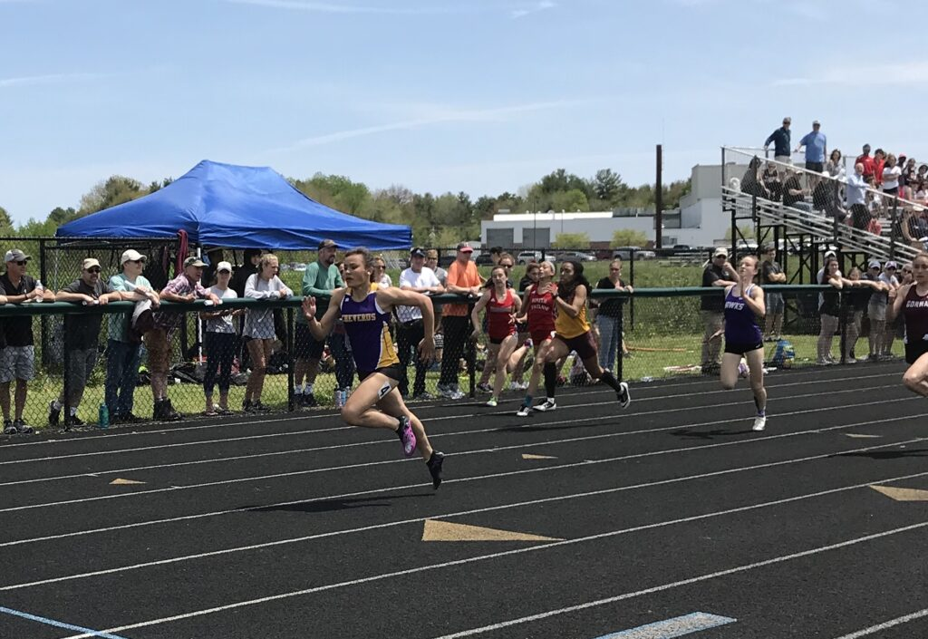 Cheverus sophomore Victoria Bossong powers to an SMAA meet record in the 100-meter dash.
