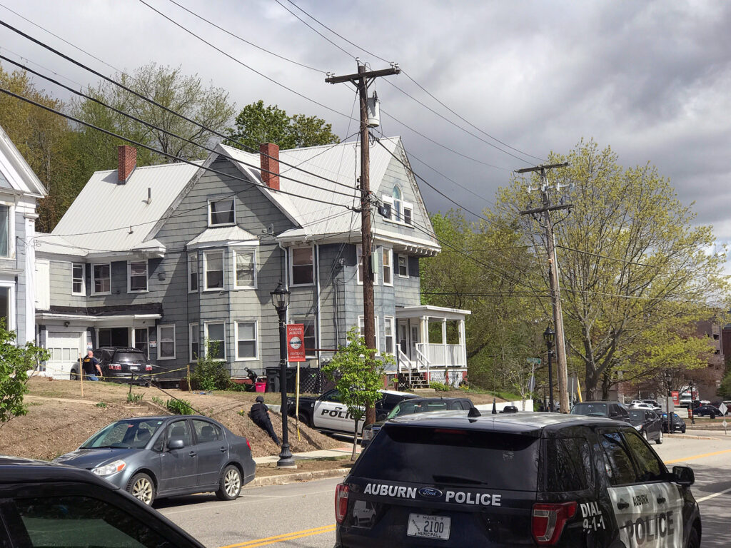 Law enforcement officers surround a house May 21, 2019, at 185 Main St. in Auburn.