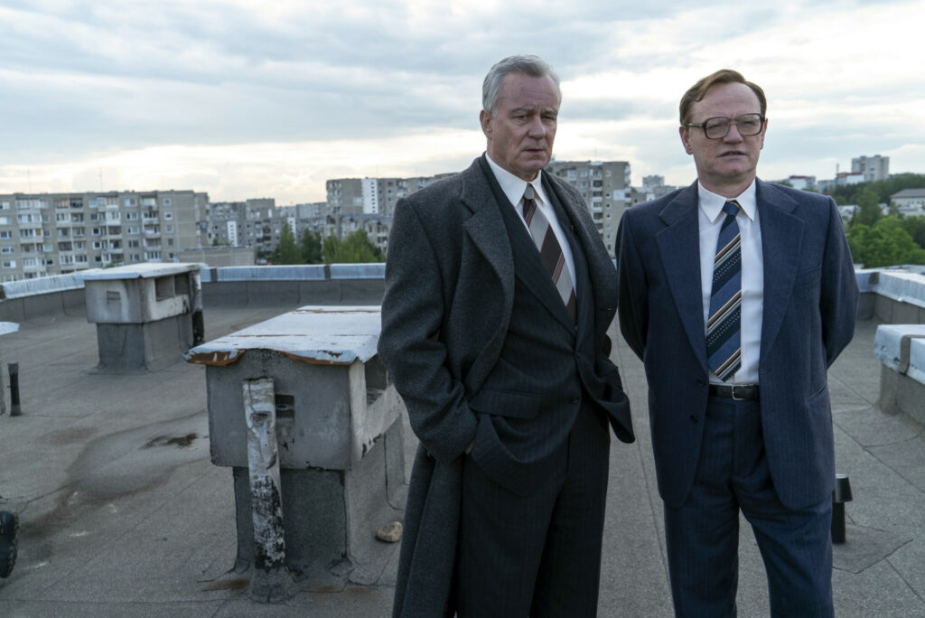 "Boris Shcherbina (Stellan Skarsgard), left, travels to Pripyat, Ukraine, with the U.S.S.R.'s leading nuclear physicist, Valery Legasov (Jared Harris), in HBO's acclaimed series ""Chernobyl."""