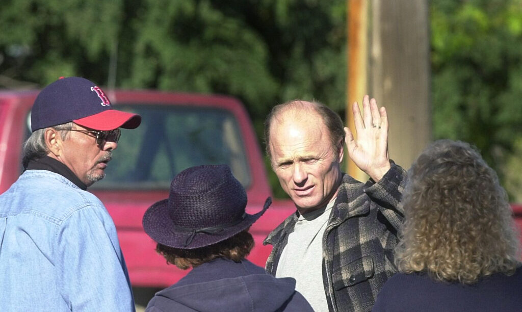 "Ed Harris waves to a crowd of onlookers during a break from shooting on the set of ""Empire Falls"" at the Bob In in Waterville on Oct. 3, 2003."